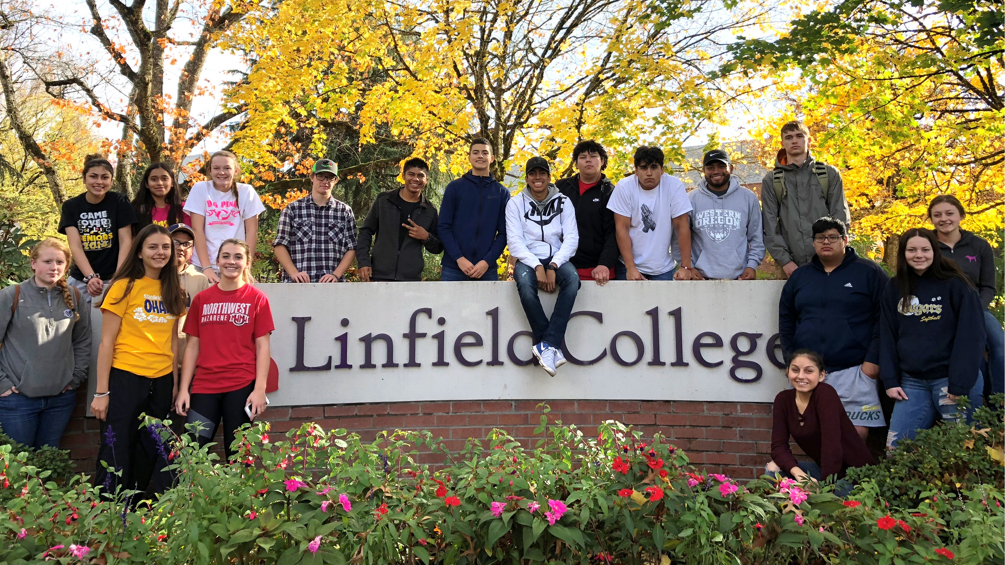 Group of Stanfield students by Linfield College sign